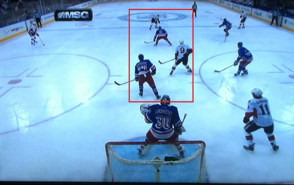 Hank looks like he's having trouble seeing the shot.