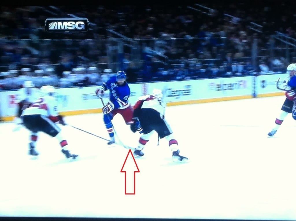 Gryba's stick on the puck, lucky bounce for Nash.