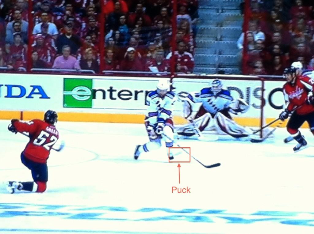 Deflects off Stepan's stick past Hank.