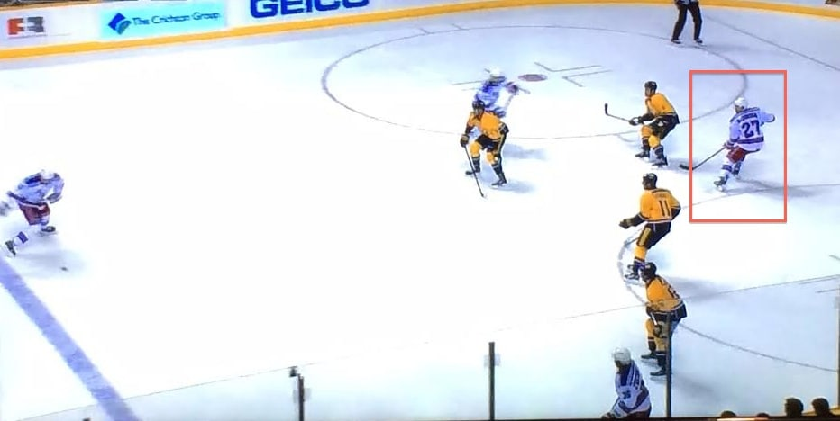 Four yellow jerseys watching the puck.