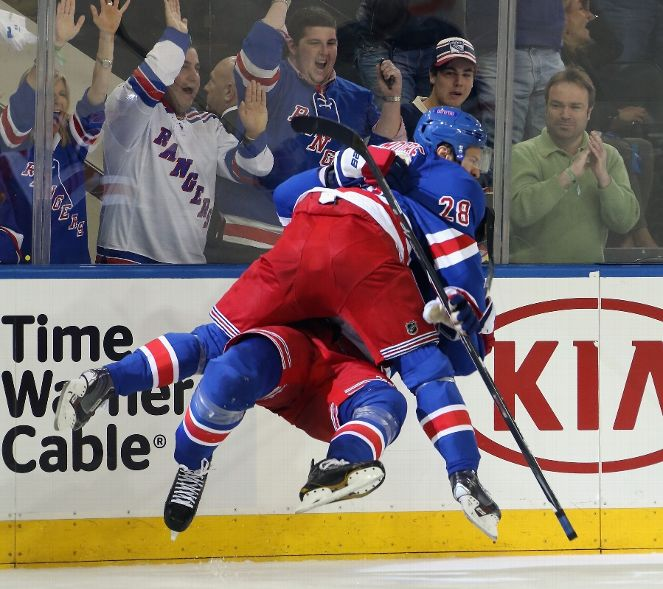 Score a goal, tackle a giant. (Photo by Bruce Bennett/Getty Images)