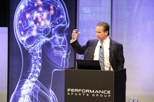 At a Performance Sports Group event earlier today in New York, leading neurosurgeon Dr. Julian Bales unveiled a new device designed to reduce mild traumatic brain injury (mTBI) in sports. The proprietary band, worn on the neck, is the first device of its kind to reduce the risk of mTBI internally by using the body's own physiology rather than external protective devices. (PRNewsFoto/Performance Sports Group Ltd.)